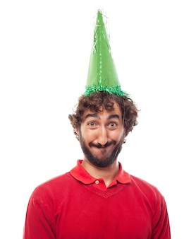 Smiling guy wearing a green party hat