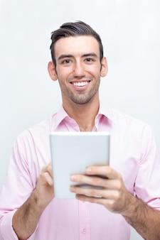 Smiling Handsome Business Man Using Tablet