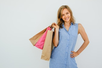 Smiling Lovely Woman Holding Shopping Bags