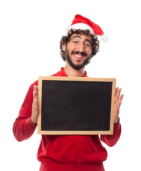 Smiling man holding a chalkboard with both hands