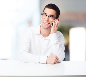 Smiling man talking on the phone