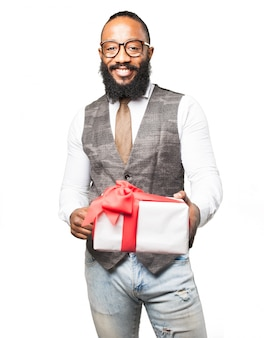 Smiling man with a white gift with red bow