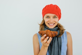 Smiling Pretty Woman Holding Delicious Croissant