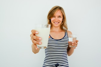 Smiling Pretty Woman Offering Glass of Milk