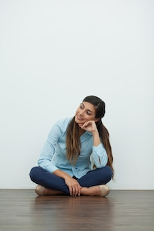 Smiling Relaxed Beautiful Woman Sitting on Floor