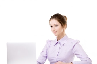 Smiling secretary working with laptop