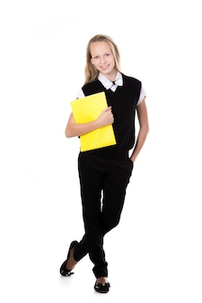Smiling student holding a yellow folder