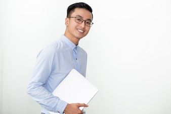 Smiling Student in Glasses Carrying Laptop