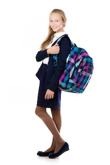 Smiling student with a plaid backpack