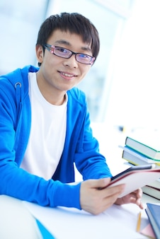 Smiling student with his digital tablet