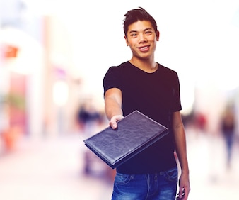 Smiling teenager showing a black diary