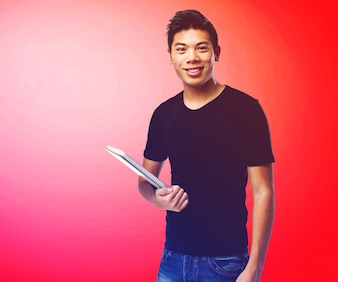 Smiling teenager with a notebook