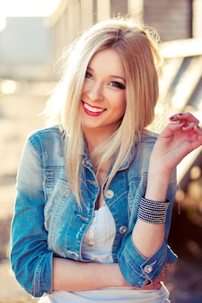 Smiling teenager with denim jacket