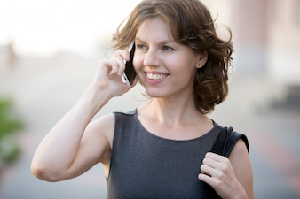 Smiling woman talking on a mobile
