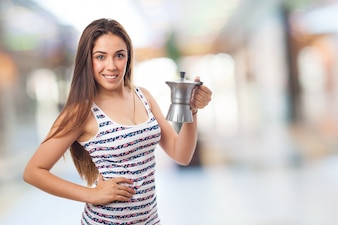 Smiling woman with a coffee maker