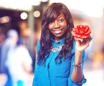 Smiling woman with a red flower