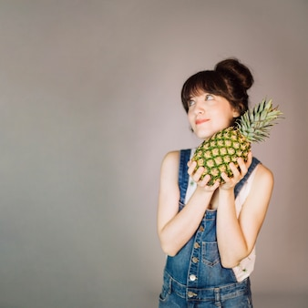 Smiling woman with pineapple