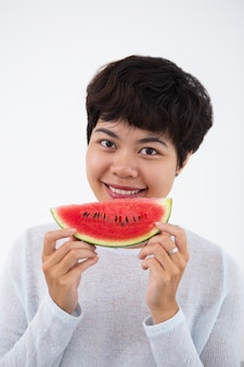 Smiling Young Asian Woman Holding Watermelon
