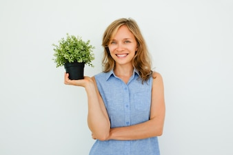 Smiling Young Beautiful Woman Holding Pot Plant