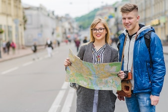 Smiling young couple with map