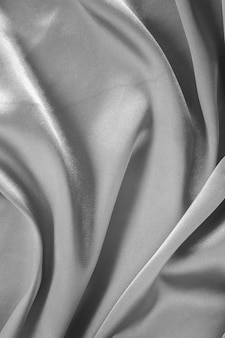 Smooth elegant gray silk or satin texture use for background.
