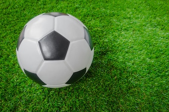 Soccer ball on green grass .