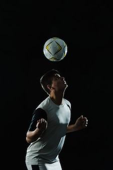 Soccer player using his head to hit the ball