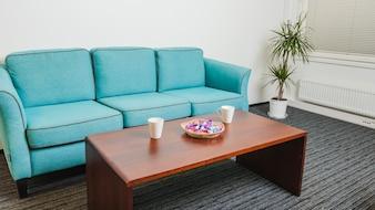 Sofa and table standing on gray rug