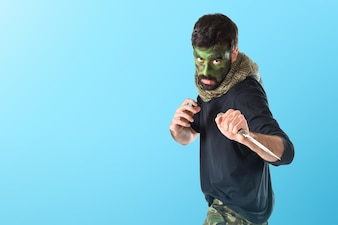 Soldier with knife  on colorful background