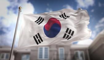 青空の建物の背景に韓国の国旗の3Dレンダリング