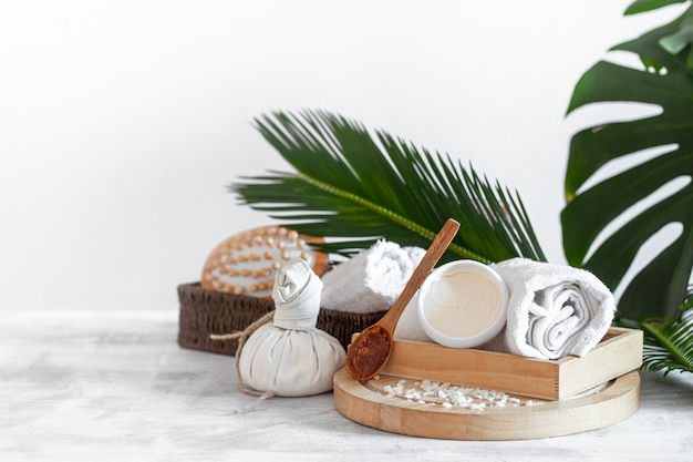 Spa composition with care items on a light wall