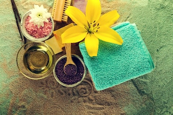 Spa Concept. Closeup of beautiful Spa Products - Spa Salt, Towels and Flowers. Horizontal.