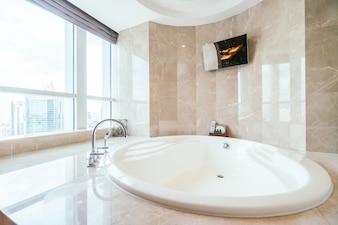 Spacious bathtub next to a window