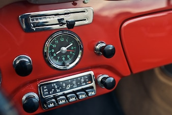Speedometer of a car inside and old radio