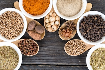 Spices and herbs in  bowls.