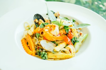 Spicy seafood spaghetti or pasta in white plate