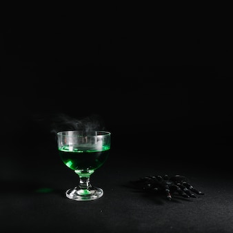 Spider and smoking poison in glass