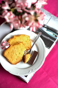 Sponge cake with a piece of chocolate for breakfast