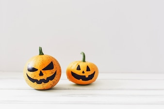 Spooky pumpkins on white background
