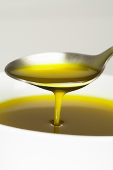 Spoon with olive oil