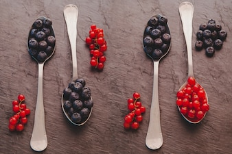 Spoons with red fruits