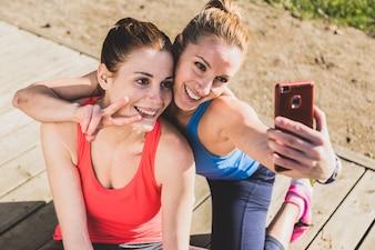 Sportswomen taking a photo