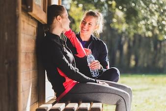 Sportswomen talking after sport