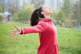 Sporty woman feeling alive