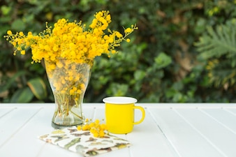 Spring composition with flowers, mug and notebook