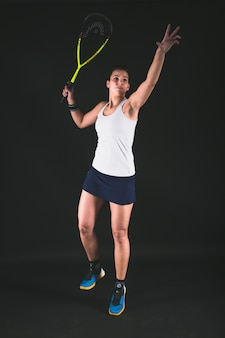 Squash player serving a ball