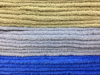 Stacked Fluffy Towels Texture Background