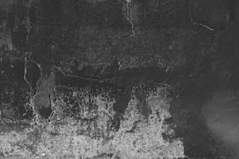 Stained black and grey stucco wall