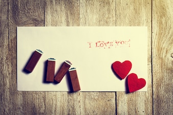 Stamps on a paper with hearts with the phrase  i love you
