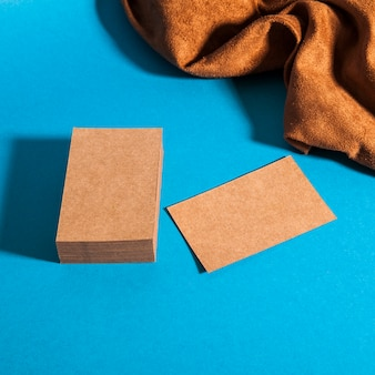 Stationery mockup with cardboard business cards and cloth
